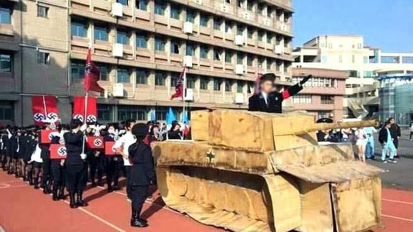 Taiwanese students, whose faces have been digitally obscured, wear Nazi uniforms during a mock rally Dec. 23 at a school in Hsinchu.