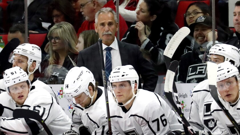 Los Angeles Kings coach Willie Desjardins watches his team play the Carolina Hurricanes during the s