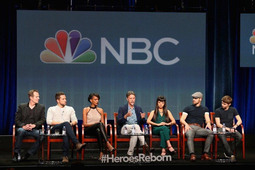 """Heroes Reborn"" executive producer Tim Kring, center, with actors, from left, Jack Coleman, Zachary Levi, Judi Shekoni, Kiki Sukezane, Ryan Guzman and Robbie Kay."
