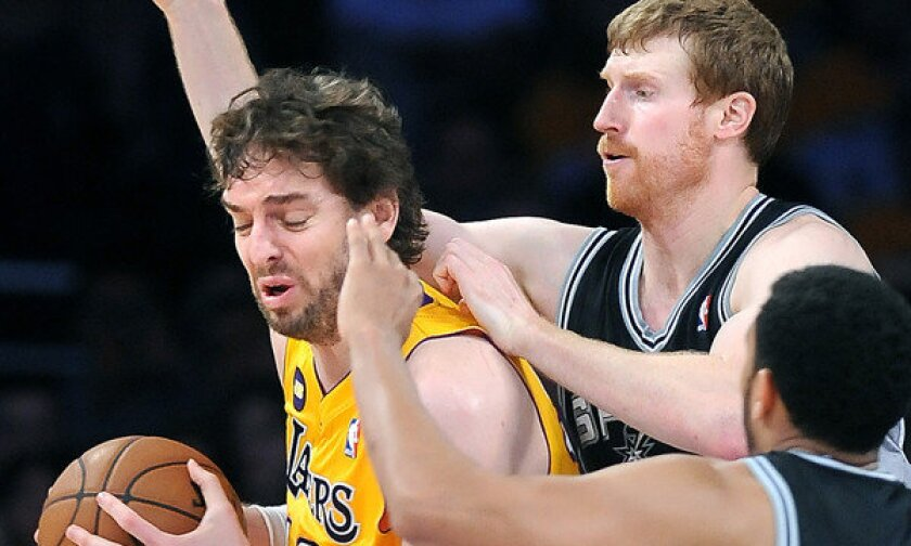 Lakers power forward Pau Gasol is double-teamed by the Spurs' Matt Bonner and Cory Joseph during a playoff game in April. Gasol missed 33 games last season with knee and foot problems.
