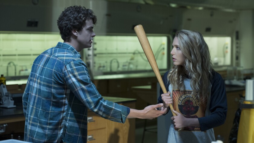 "Israel Broussard and Jessica Rothe in the movie ""Happy Death Day 2U."""