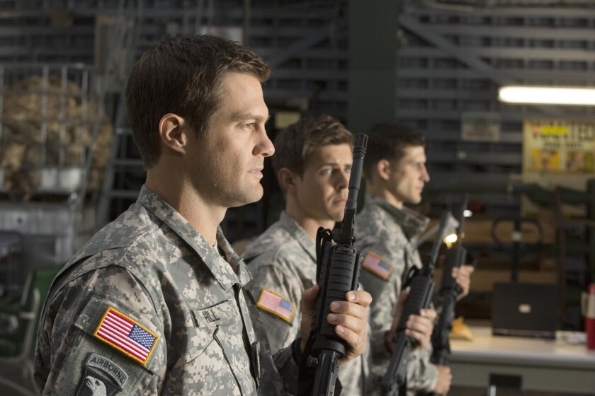 "Geoff Stults, left, Chris Lowell and Parker Young play brothers in a rear detachment unit in the Army comedy ""Enlisted,"" returning Sunday to Fox for the first of four last episodes."
