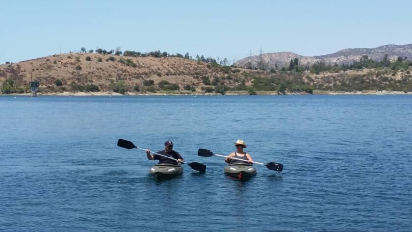 Kayakers enjoy time on the water at Lake Jennings.