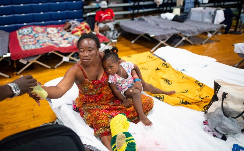Teresa Okoma Wayemala with her daughter, Melissa, 2, from Congo