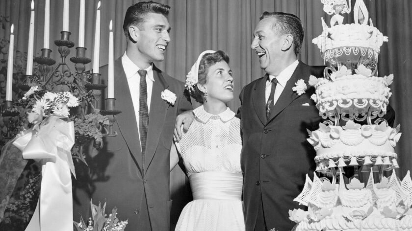 Walt Disney, right, congratulates his daughter Diane, 20, and Ron Miller, 21, at a reception following their May 9, 1954, marriage in Montecito, Calif. Miller, who later become CEO of Disney, died Saturday at 85.