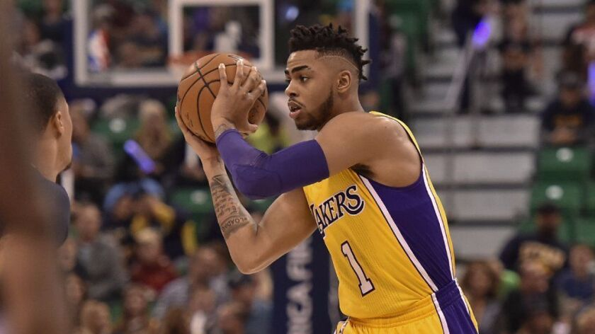 Lakers guard D'Angelo Russell controls the ball during the first half of a game against the Utah Jazz on Oct. 28.