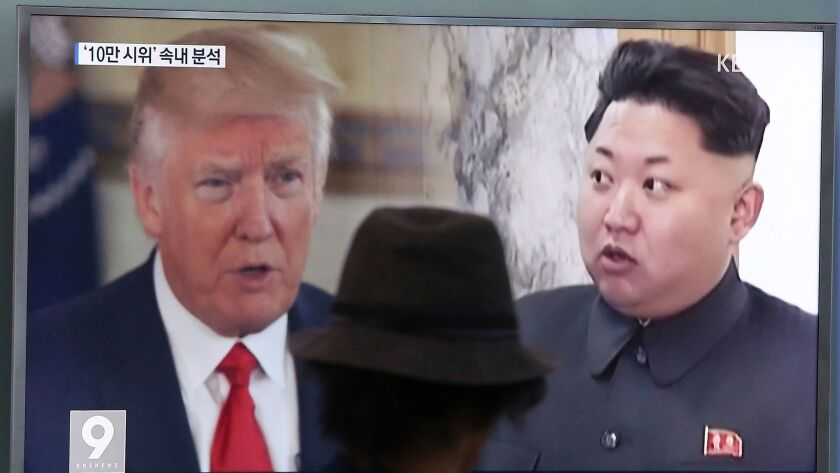 A television screen in Seoul, South Korea, shows President Trump and North Korean leader Kim Jong Un on Aug. 10.