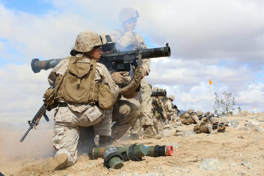 Sgt. Emma Bringas, serving as assistant gunner and anti-tank missileman, and Lance Cpl. Terrence Lay fire an MK153 shoulder-launched multipurpose assault weapon (SMAW) at Twentynine Palms in March, during combat trials with the Ground Combat Element Integrated Task Force. (U.S. Marine Corps photo by Sgt. Alicia R. Leaders/Released)