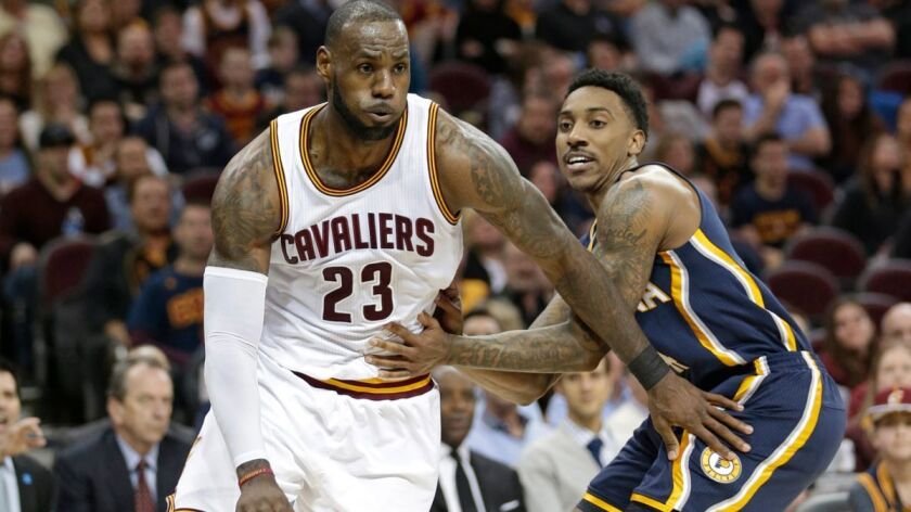 Cleveland Cavaliers' LeBron James (23) drives against Indiana Pacers' Jeff Teague (44) in the first