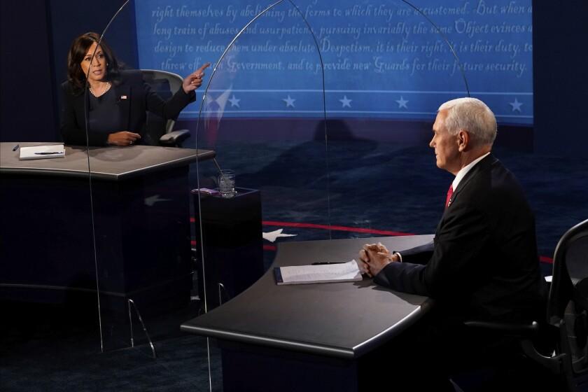 Sen. Kamala Harris gestures toward Vice President Mike Pence during the vice presidential debate Wednesday.