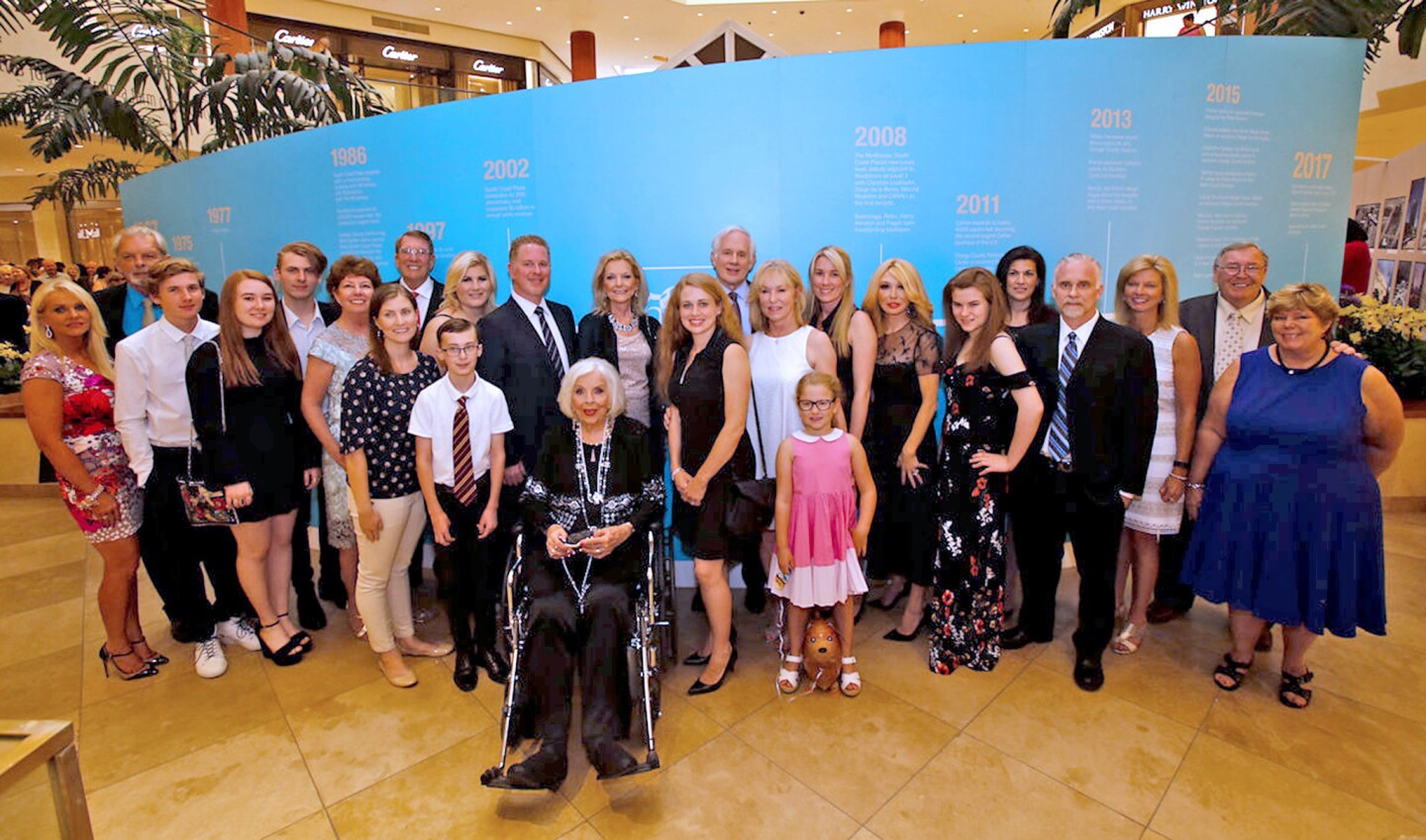 """The extended Segerstrom family celebrated its legacy at the exhibit """"Pioneering Spirit: An American Dream,"""" on display at South Coast Plaza through July 30."""
