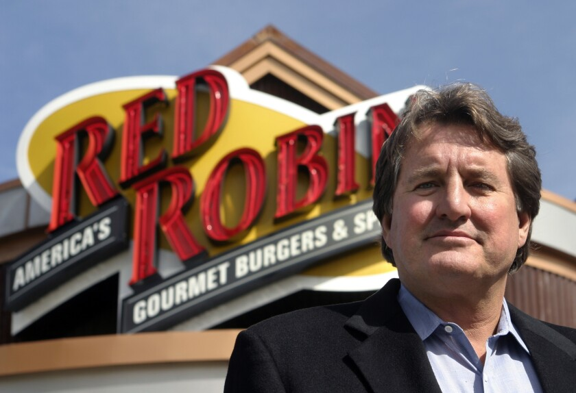 Mike Snyder, the first franchisee of the popular burger chain Red Robin who was ousted from the company in 2005 for misusing funds, died Sunday of an apparent suicide. He was 68.