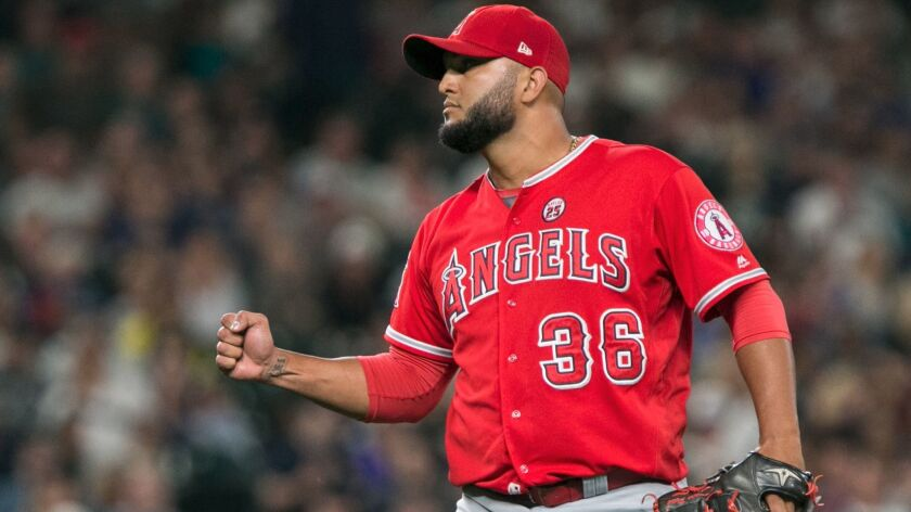 Angels pitcher Yusmeiro Petit celebrates after a win over the Seattle Mariners on Aug. 11.