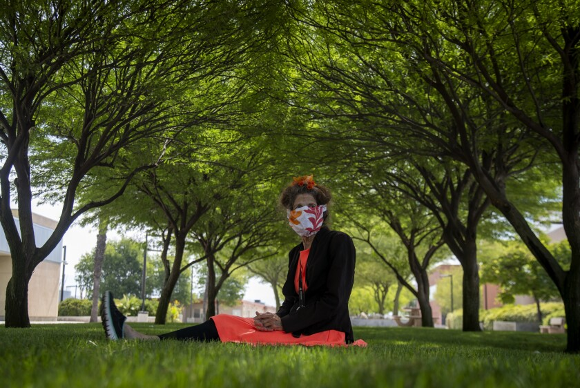 Activist Albia Miller sits  under a canopy of shade trees at the Menifee Valley campus of Mt. San Jacinto College