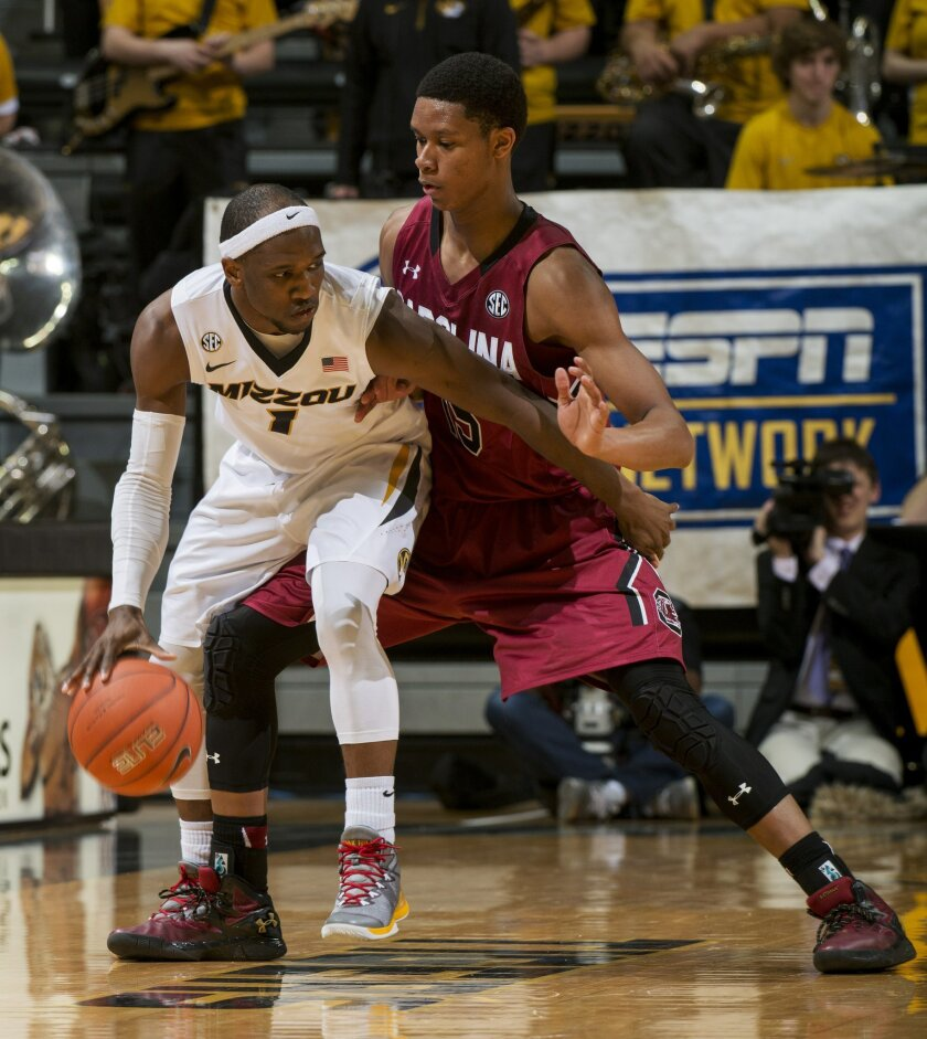Missouri's Terrence Phillips, left, pushes past South Carolina's PJ Dozier, right, during the second half of an NCAA college basketball game, Tuesday, Feb. 16, 2016, in Columbia, Mo. Missouri won the game 72-67. (AP Photo/L.G. Patterson)