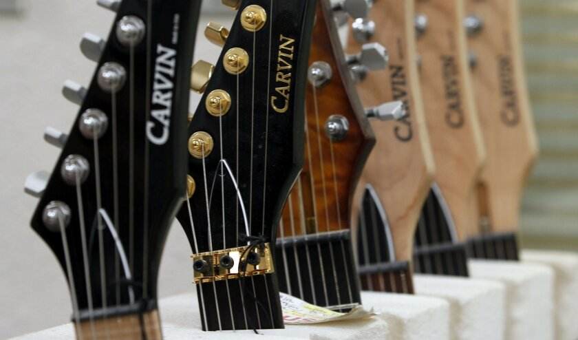Carvin's logo adorns finished guitars at the factory.
