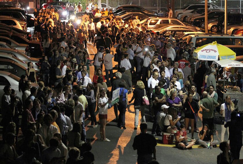 Hundreds of voters wait in long lines to cast their ballots on election day in Miami.