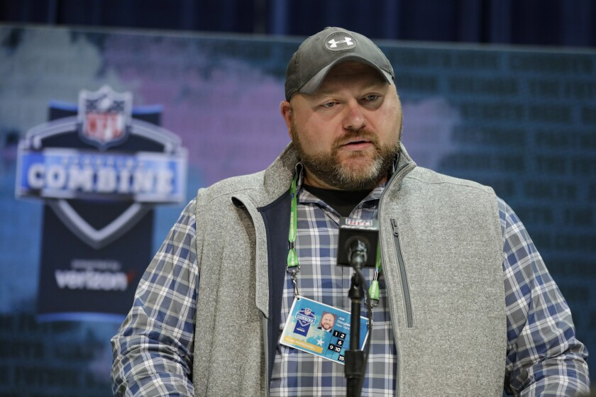 FILE - In this Feb. 25, 2020, file photo, New York Jets general manager Joe Douglas speaks during a news conference at the NFL football scouting combine in Indianapolis. Douglas is not going to start patting himself on the back after a busy offseason. Douglas made several moves to help the team get better, but he knows they're still very much a work in progress. (AP Photo/Michael Conroy, File)