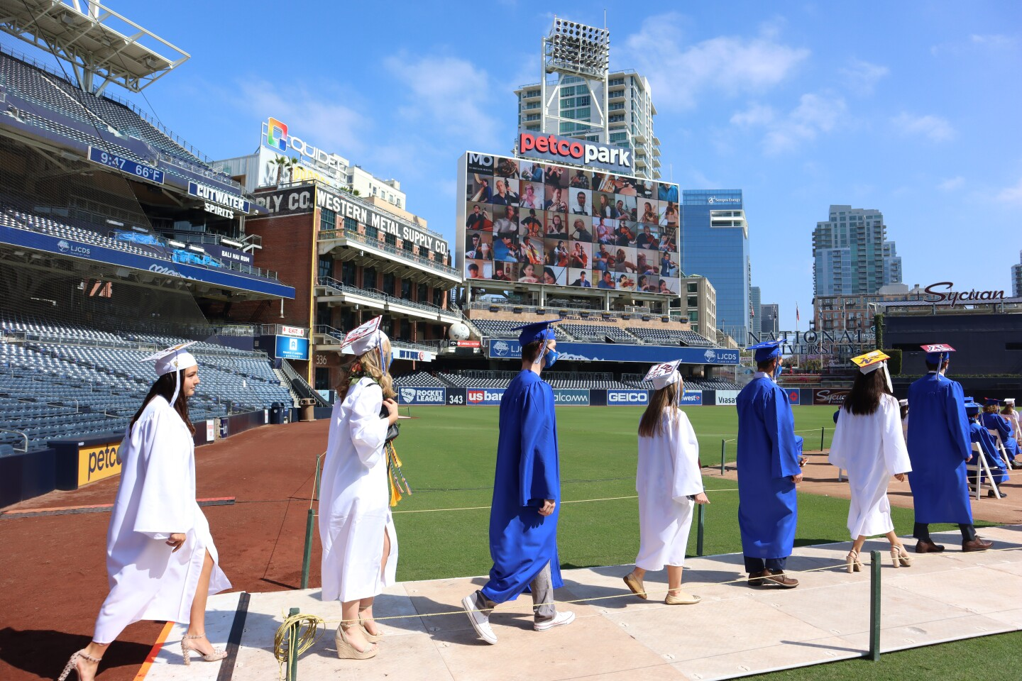 La Jolla Country Day School seniors file onto the field at Petco Park in San Diego for their graduation ceremony May 28.