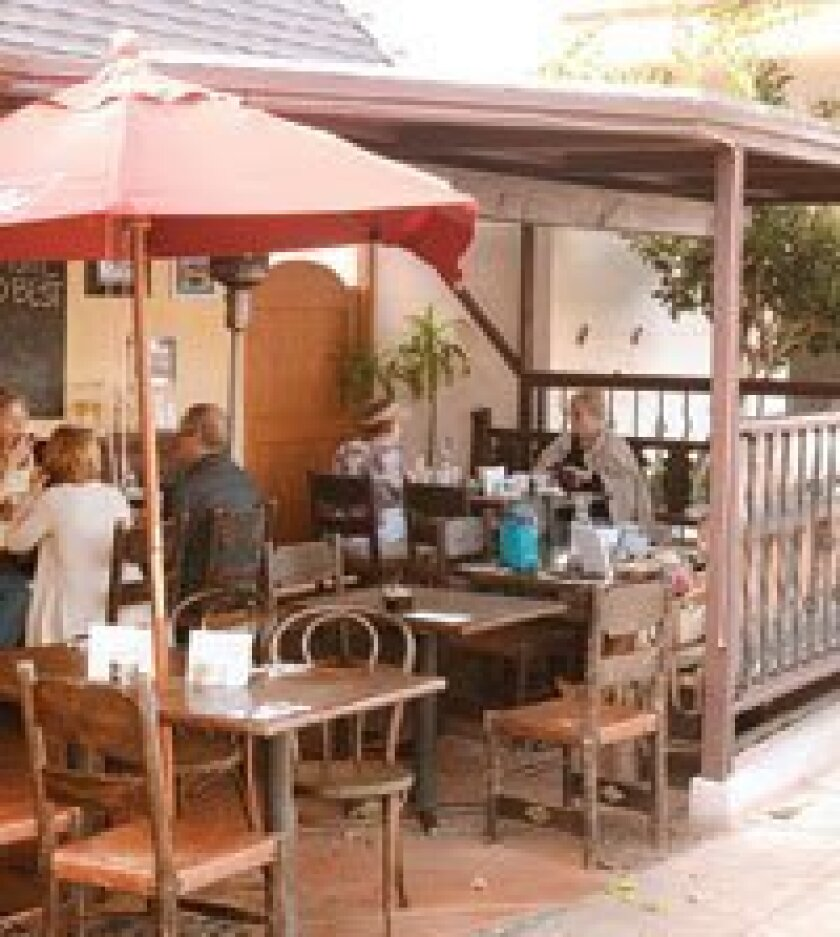 Guests dine on the patio at Cafe Secret.