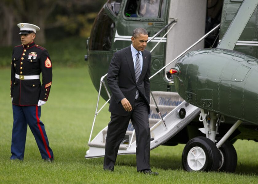 President Obama's recently announced proposal to develop a college rating system was met with skepticism Wednesday at a forum at Cal State Dominguez Hills. Above, the president walking Tuesday from Marine One on the South Lawn of the White House.