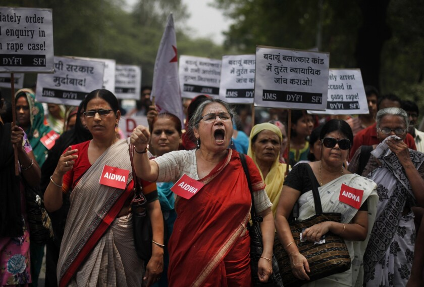 Members of the All India Democratic Women's Assn. shout slogans May 31 in New Delhi during a protest over the gang rape last week of two girls.