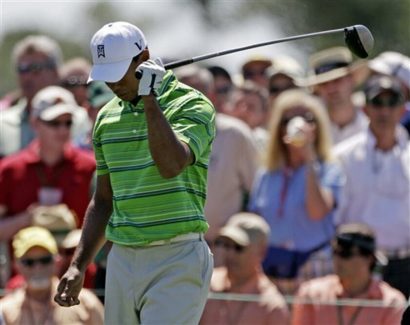 Tiger Woods reacts after his drive off the eighth tee during the first round of the Masters golf tournament Thursday, April 7, 2011, in Augusta, Ga. (AP Photo/David J. Phillip)