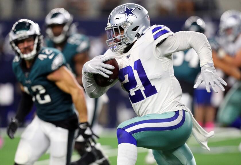 Dallas Cowboys running back Ezekiel Elliott carries the ball against the Philadelphia Eagles on Sunday.