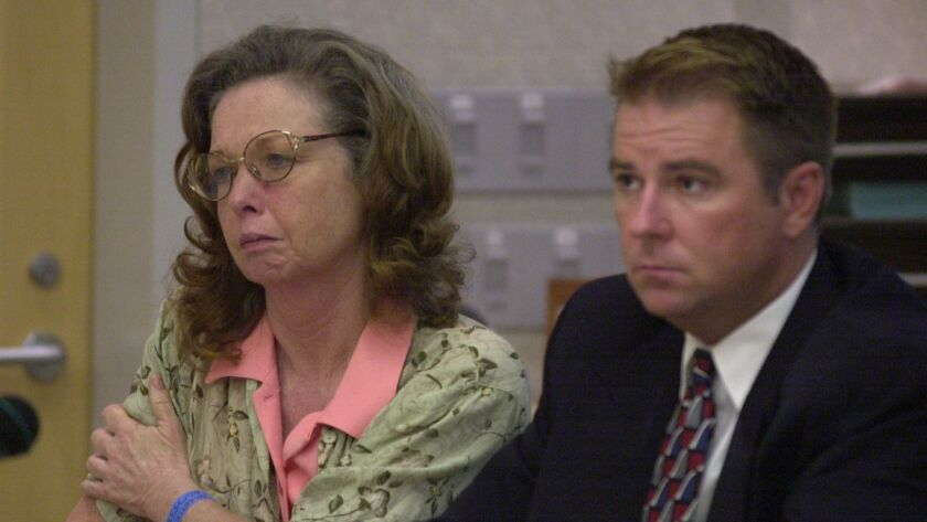 Jane Dorotik listens to testimony during a sentencing hearing in San Diego County Superior Court on July 26, 2001. Defense attorney Cole Casey is seated next to her.