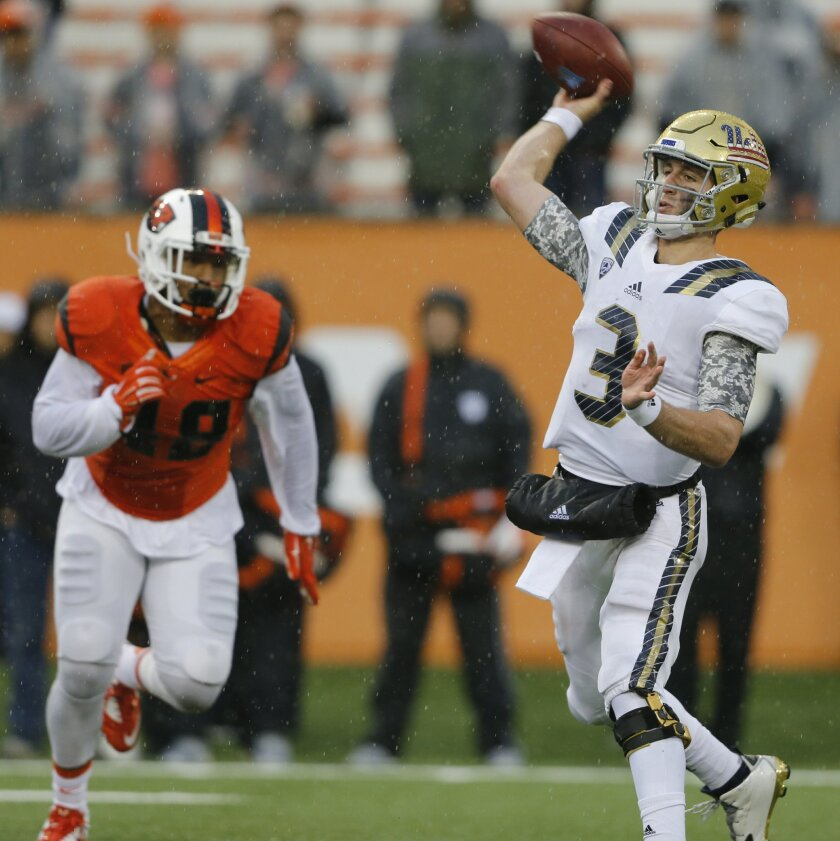 UCLA quarterback Josh Rosen throws a pass in the second half of an NCAA football game against Oregon State in Corvallis, Ore., on Saturday, Nov. 7, 2015. UCLA defeated Oregon State 41-0. (AP Photo/Timothy J. Gonzalez)