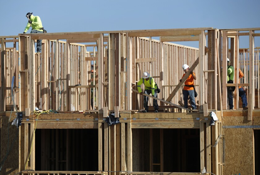 Framers work at the Enclave Otay Ranch Apartments in Chula Vista earlier this year.