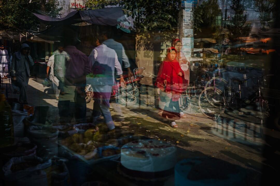 People walk in a street market.