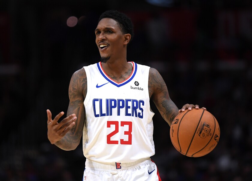 Clippers guard Lou Williams brings the ball up court during a preseason game against the Nuggets on Oct. 10, 2019.