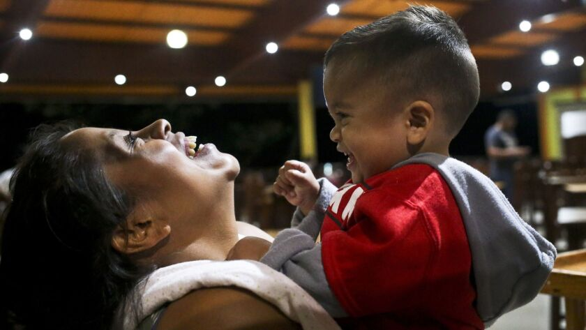 Adalicia Montecinos holds her year-old son Johan, who became a poster child for the U.S. policy of s