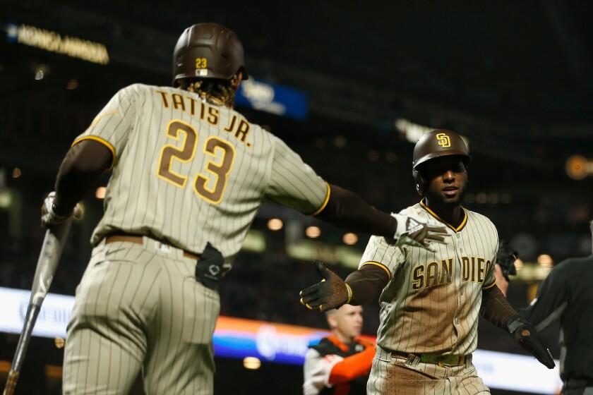 The Padres' Jurickson Profar celebrates with Fernando Tatis Jr.