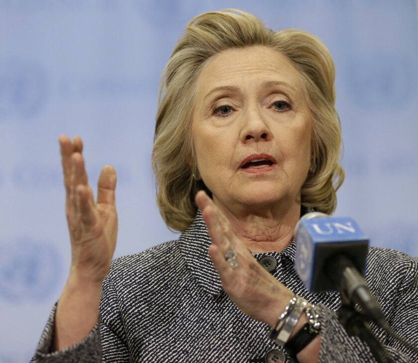 FILE - In the March 10, 2015 file photo, former Secretary of State Hillary Rodham Clinton speaks to the reporters at United Nations headquarters. The Associated Press filed a lawsuit Wednesday against the State Department to force the release of email correspondence and government documents from Hi