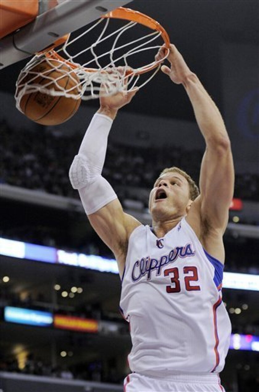 Los Angeles Clippers forward Blake Griffin dunks during the first half of their NBA basketball game against the Sacramento Kings, Saturday, April 7, 2012, in Los Angeles. (AP Photo/Mark J. Terrill)