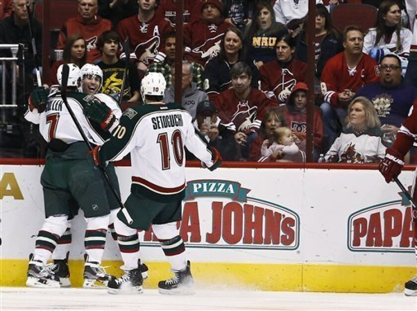 Minnesota Wild's Jason Zucker celebrates his goal against the Phoenix Coyotes with Matt Cullen (7) and Devin Setoguchi (10) during the first period in an NHL hockey game,Thursday, Feb. 28, 2013, in Glendale, Ariz. (AP Photo/Ross D. Franklin)