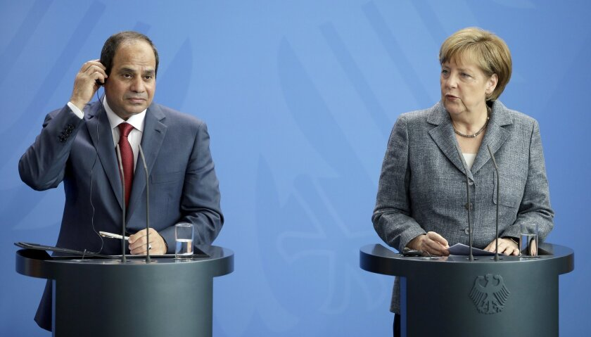 German Chancellor Angela Merkel, right, and the President of Egypt Abdel Fattah el-Sissi address the media during a joint press conference as part of a meeting at the chancellery in Berlin, Germany, Wednesday, June 3, 2015. (AP Photo/Michael Sohn)