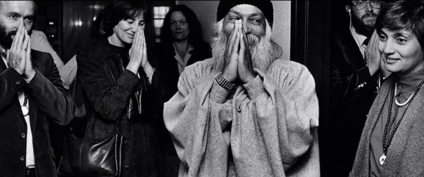 "Bhagwan Rajneesh and Ma Anand Sheela in a scene from the Netflix docuseries, ""Wild Wild Country."""
