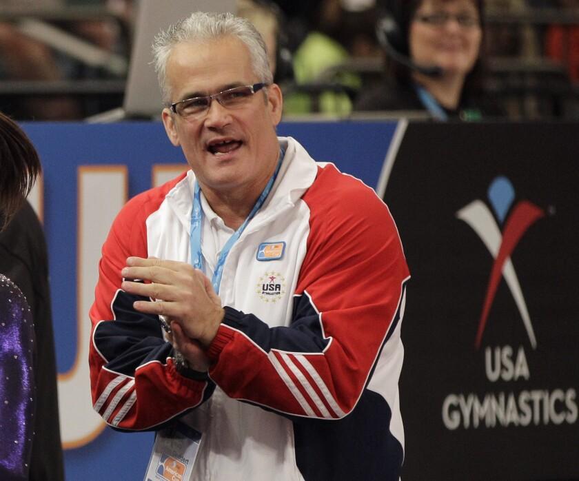 ARCHIVO - En esta foto del 3 de marzo de 2012, el entrenador de gimnasia John Geddert.