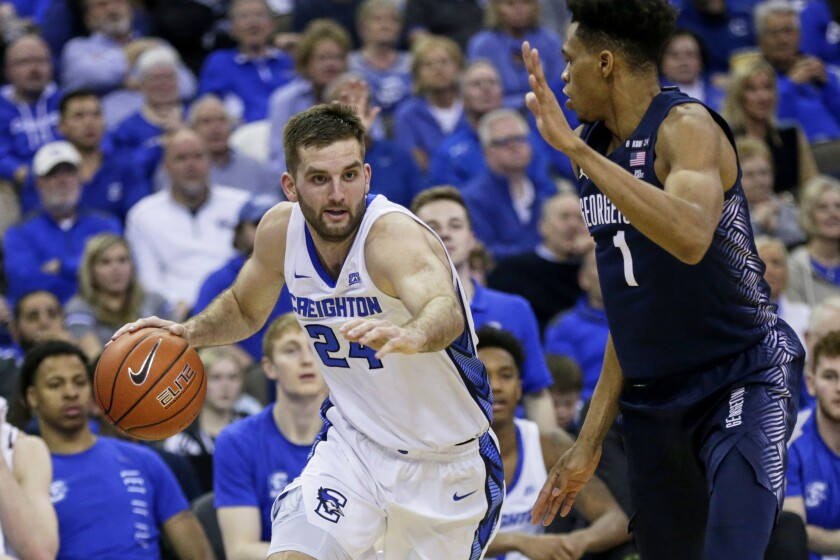 Creighton's Mitch Ballock (24) drives past Georgetown's Jamorko Pickett (1) during the second half of an NCAA college basketball game in Omaha, Neb., Wednesday, March 4, 2020. Creighton won 91-76. (AP Photo/Nati Harnik)