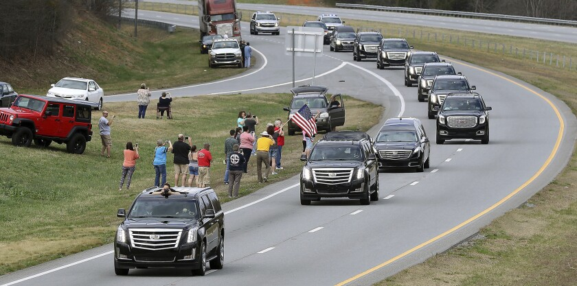 The Billy Graham procession drives south on U.S. 321 near Dallas. N.C. as it passes through Gaston County on it's way to Billy Graham Library in Charlotte, N.C., Feb. 24, 2018.