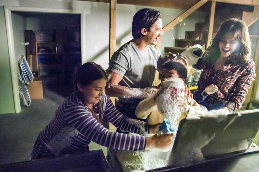 """Milo Ventimiglia stars as Jack, second from left, and Mandy Moore as Rebecca in """"This Is Us."""""""