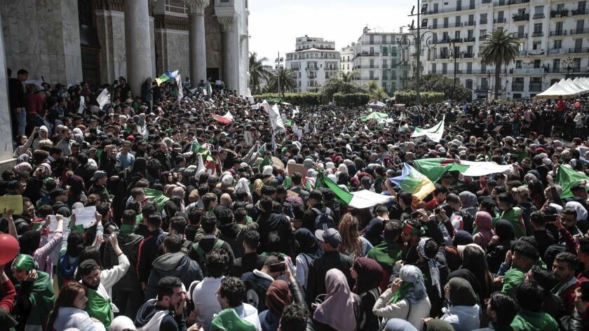 Students wave flags and chant slogans during a demonstration in Algiers, Algeria, Tuesday, April 9,