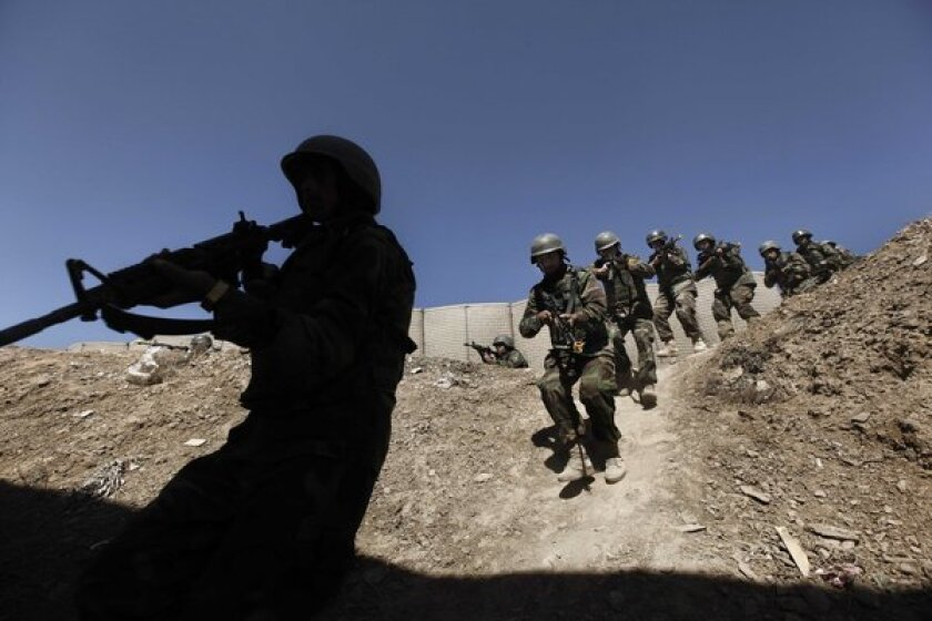 Afghan National Army commandos practice a house-clearing operation during training with U.S. forces on the outskirts of Kabul in March 2011. Special forces training of local security forces in countries afflicted with regional conflicts involving Islamic extremist groups would spare the U.S. direct involvement and its consequences, international security experts say.