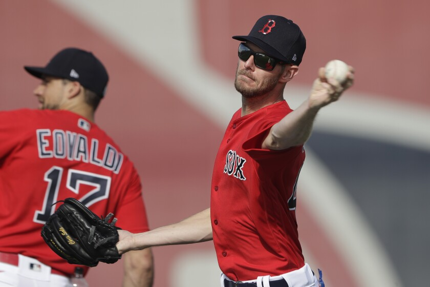 Red Sox starting pitcher Chris Sale throws during spring training baseball camp Wednesday, Feb. 19, 2020, in Sarasota, Fla.