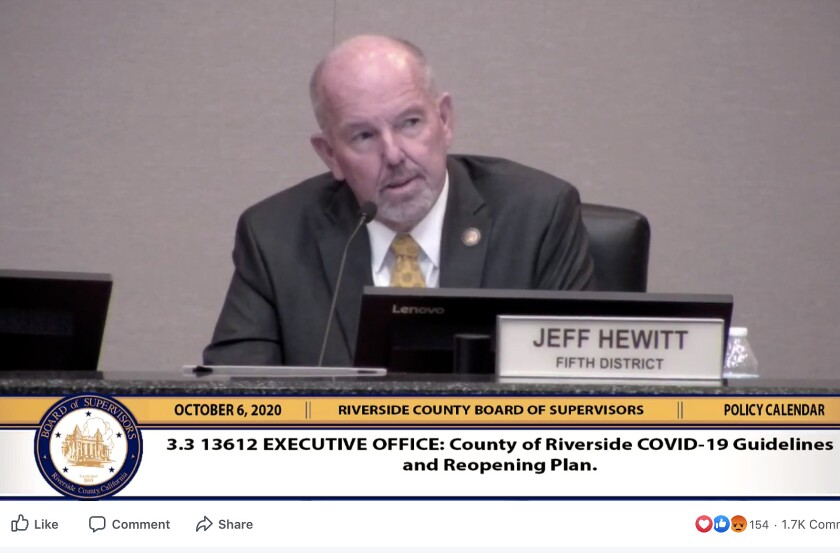 Jeff Hewitt speaks into a microphone at a Riverside County Board of Supervisors meeting.