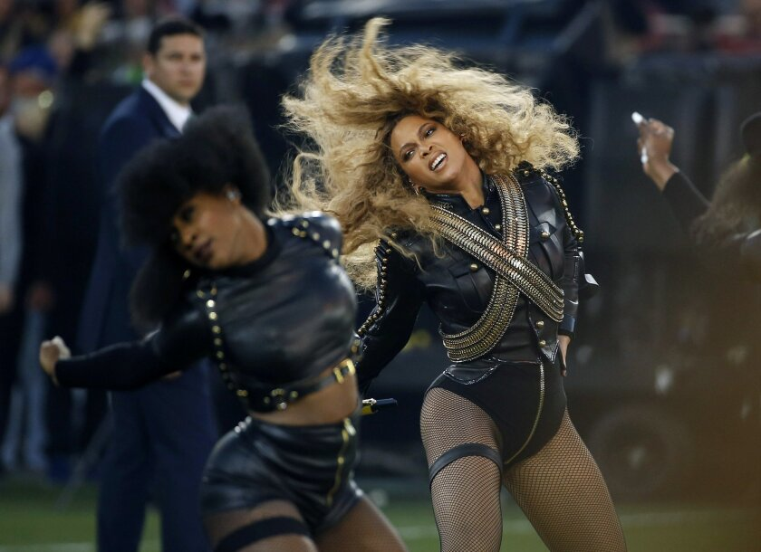 "FILE - In this Sunday, Feb. 7, 2016, file photo, Beyonce performs during halftime of the NFL Super Bowl 50 football game in Santa Clara, Calif. Red Lobster said in a statement that its sales surged after Beyonce mentioned the chain in a ""Formation"" lyric. The seafood chain known for its cheddar bis"
