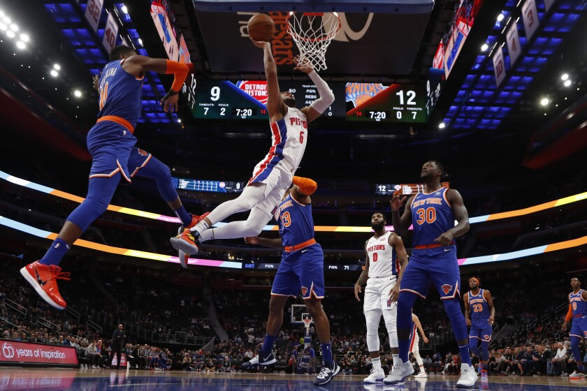 Detroit Pistons guard Bruce Brown (6), defended by New York Knicks guard Frank Ntilikina (11) makes a layup during the first half of an NBA basketball game, Wednesday, Nov. 6, 2019, in Detroit. (AP Photo/Carlos Osorio)